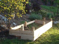 Raised garden bed for steep slope. DIY