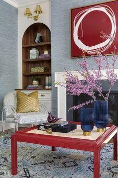 Black Accent Table, White Accent Chair, Blue Accent Chairs, Lime Green Rug, Red Coffee Tables, Art Deco Fireplace, Dark Blue Walls, Printed Sofa