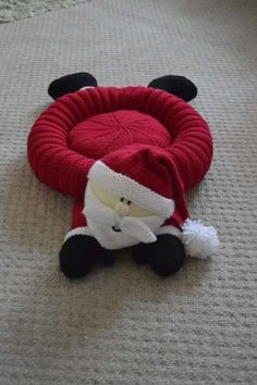 Here is an unusual Christmas knitting pattern to make a Santa Snuggler Pet bed for small dog or animal.