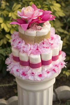 Pretty diaper cake at a rustic princess baby shower party! See more party planning ideas at CatchMyParty.com!