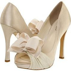 Off white high heels with bows on the toes, cute. #weddingshoes