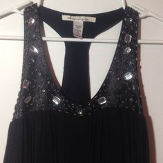 Layered Black Sequin Dress NWOT black layered/tiered dress from American Rag. Has beads and sequins on front and back. Xs but fits more like a small American Rag Dresses