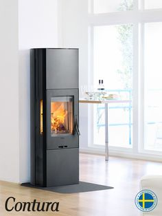 Woodburner with black steel surround, glass or cast iron door and glass top.