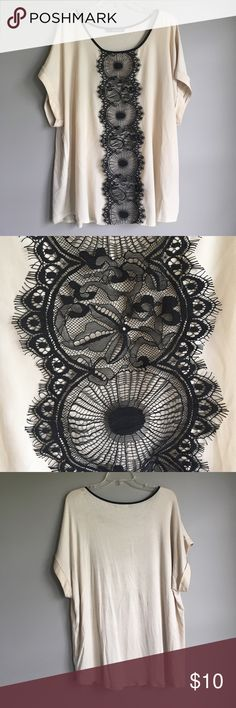 """Lace trim top Cream colored top with black black trim. """"Business in the front and casual in the back"""" top is rayon / blouse fabric front and soft stretchy t-shirt fabric back. Noticed a tiny hole from a pick on the back at the shoulder. Not noticeable Maurices Tops Blouses"""