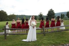 Bridesmaids and bride... in a field.    www.easphotography.biz