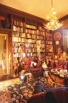 """Busy, Victorian-style home library.  Can you say """"eclectic?"""""""