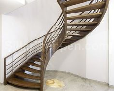 escalera circular con zancas laterales (estructura y peldaños de madera) AMSTERDAM HELICAL Siller Stairs