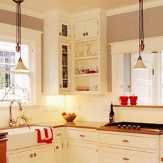 How to Turn Upper Cabinets to Instant Shelving: Remove the doors on a bank of upper cabinets, then paint the interiors for instant open shelving. #DIY #HomeImprovement #HomeDecor #Crafts #HomeDesign #HomeRemodeling #HomeRepair