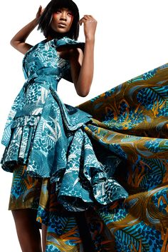 Vlisco: Silent Empire Collection: Dutch Wax patterns with hints of Japanese accents in tailoring, fabric cut, and of course styling. Love!