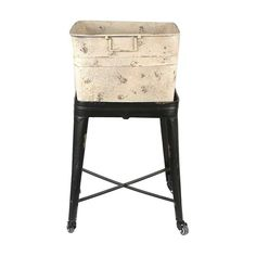 Our farmhouse dreams come to life with this distressed metal washtub stand. Metal casters make it mobile, so you can place it anywhere in your bathroom or washroom. It's also a fun way to store extra t...  Find the Old-School Rolling Washtub, as seen in the Lovely French Farmhouse Collection at http://dotandbo.com/collections/lovely-french-farmhouse?utm_source=pinterest&utm_medium=organic&db_sku=CCO0301