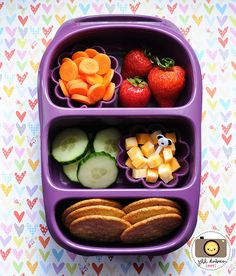 This fun bento was for afternoon nutrition break and was packed in our goodbyn bynto. The top section held a stack of whole wheat crackers and a silicone muffin cup with cubed marble cheese and a cute lion pick. The middle section held 2 silicone muffin cup - one with sliced baby carrots and 1 with sliced cucumbers. The bottom section held some melon balls - watermelon, honeydew and cantaloupe.