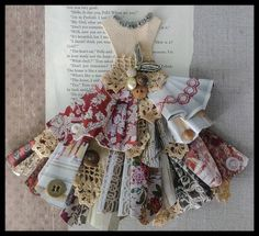 Feeling inspired using paper for my Shadowbox dresses folded paper layered with vintage linen and lace ....old buttons....jewelry elements...background is linen, paper, and vintage book page. Number 2....more ahead: