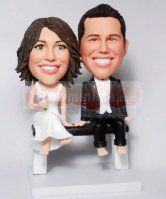 Sitting on a bench custom Cake Toppers BW30  send a picture and they look like you