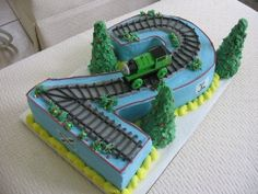 Two shaped train cake By LoriMc on CakeCentral.com