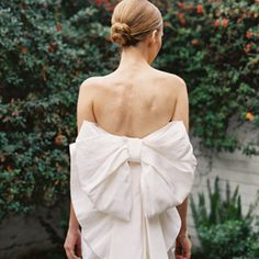 This bow-backed Lanvin gown is a must-see, also the bride's minimalist accessories for this statement dress (photo Chudleigh Wedding).