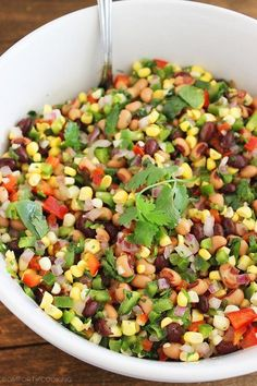 Texas Caviar – Serve this fresh, zesty corn salad with beans, bell peppers and jalapenos on the side of grilled meats and fish, or on top of burgers and crostini! | thecomfortofcooking.com