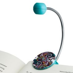 The Disc Reading Light by WITHit is the perfect portable LED reading light that fits e-readers and books. This LED book light was designed to reduce light glare with a specially designed, owl emblem. #booklamp #readinglight #readinglamp #bookshelf #bedlamp #bedroomdesign #bedroom #beds #interiordesign #designlamp