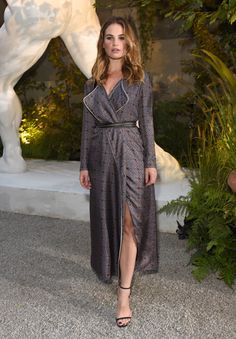 My Burberry campaign star Lily James arrives at the show space wearing a Burberry Printed Silk Wrap Trench Dress from the September collection