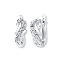 Ribbons of polished sterling silver and sparkling diamonds swirl around each other in these lovely earrings for her. The earrings have a total diamond weight of 1/15 carat and secure with hinged backs. Diamond Total Carat Weight may range from .065 - .08 carats.
