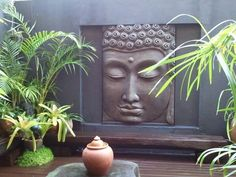 Buddha plaque - in between windows at the front of the house?