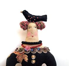 Textile art cloth art doll with black bird on top of her head ~ Theresa Hutnick