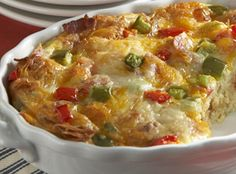 Western Egg Bake  The perfect recipe to make ahead, then bake and serve for brunch the next day. New York Brand® Texas Toast™ Cheese & Garlic Croutons are soaked in hot milk, then mixed with eggs, sharp cheddar cheese, peppers, scallions and bacon. Yum!   From Marzetti Kitchens℠.