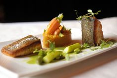 Seared salmon with garden peas & carrots