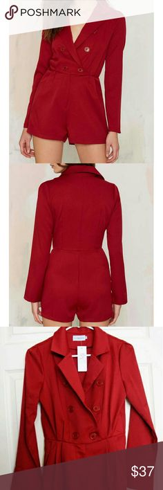 """Blazer of Glory Tux Romper Red From the site :) sold out!  """"The Blazer of Glory Romper comes in red and features double-breasted tuxedo design at top, front button and hidden zip closure, darted bust, pleated waist, front pockets, and romper design. Unlined. """"  NEW WITH TAGS! in a size extra small :) Nasty Gal Dresses Mini"""