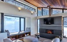 Laurentian Ski Chalet by RobitailleCurtis | Detached houses