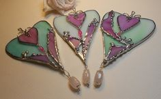Really pretty stained glass heart pendants.  Love the colors, too.