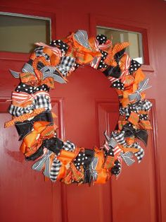 Ribbon wreath; can use bows or knots on a hanger, cheaper than foam ring.