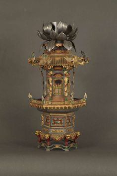 A Rare And Large Pair Of Pewter Candlesticks In The Form Of Pagodas Set with mirrors. Each formed as a six-sided pagoda surmounted by a stylized lotus candleholder. How To Make Lanterns, Chinese Design, Historical Artifacts, Chinese Lanterns, Chinese Culture, Chinoiserie, Asian Art, Flower Decorations, Vintage Items