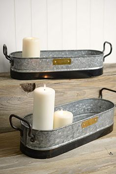 28.00 SALE PRICE! . Use this set of two Galvanized Trays as planters or to hold to hold candles at a special event. This set has a smaller tray that is 5-1/2...