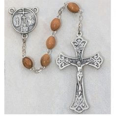 Awesome traditional looking wooden rosary to give a young man celebrating his Confirmation! Sterling silver 4 way medal as the centerpiece and a sterling silver crucifix! Includes a complimentary rosary pouch.