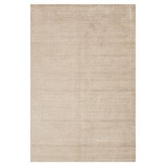 Anchor your living room seating group or define space in the den with this hand-woven eco-friendly wool and art silk rug, featuring a taupe palette....
