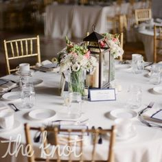 lantern lace light table decor | Glowing lanterns and pastel-hued blooms created a soft, romantic feel ...
