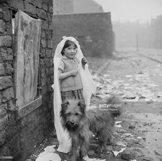 A girl wearing a wedding headdress in a slum area of Liverpool, November Original publication: Picture Post - 8995 - Liverpool Slums - unpub. Get premium, high resolution news photos at Getty Images