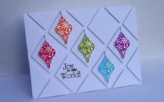 handmade Christmas card ... brightly colored heat embosed Christmas ornaments popped on Spellbinders diamonds ... like the overall pattern and the sentiment fitting into one of the diamonds...
