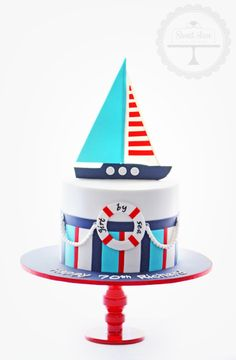 A nautical themed cake for a sailing enthusiast.
