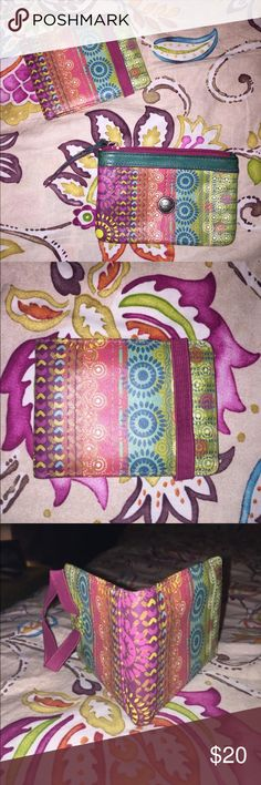 Fossil Wallet & ID Holder(Price Firm) Cute paisley print with bright colors FOSSIL Wallet and ID Holder/Keychain.. GUC.. All signs of wear shown in pictures, PLEASE OBSERVE.... Small tiny spots inside ID Holder but definitely not visible when used... No major wear really, nothin that can't be cleaned!!! Fossil Bags Wallets