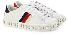 Gucci Gucci Gucci New Ace Faux Pearl Studded Leather Low-Top Sneakers $1,100 White leather upper. White/red/blue Web grosgrain detail. Back red and blue snakeskin trim. Round toe. Lace-up vamp. Leather lining. Faux pearl-studded rubber sole. Made in Italy.