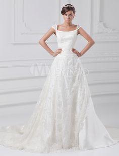 Vestido de novia marfil de tafetán con bordados