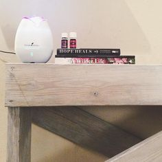 Diffusing #hyssop  #grounding on my new find at my friends market today handmade by her hubby. I'm in love with my new book table thank you @ashleyraebob!  The inspirational uplifting of hyssop oil (used in Biblical times y'all!) and the grounding assisting with emotional balance creates a lovely evening with my littles. Now to read & make some artsy journals for a special #ifgathering event next weekend!  Currently reading: @hopeheals (I highly recommend!! Like I can't say enough goodness…