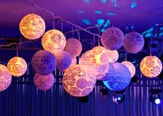 pretty sure this is just paper lanterns with paper cut-outs or doilies. cool effect. diy?