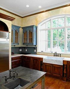 I really like this blue & yellow together, but I think it might be too dark for the basement kitchen unfortunately... I think I'll have to go with white instead & a lighter wood color.