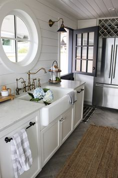 Kitchen cabinet and walls: Simply White by Benjamin Moore  Dutch door: Blue Note by Benjamin Moore  The Inspired Room