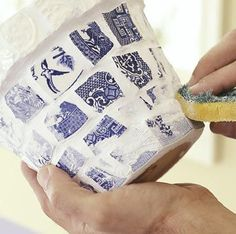 Mosaic-Look Flowerpots  Wiping grout from mosaic pieces (china adhesive used to attached to pot.)  Use grout sealer in one week.