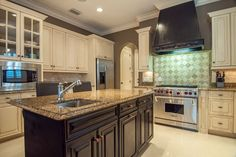 Traditional Kitchen with Limestone Tile, Undermount Sink, Crown molding, Raised panel, Venice Raised Panel Cabinet Door