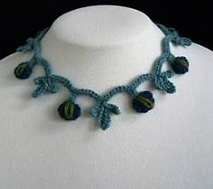 this frilly curvy light crocheted necklace is far better than those typically made ornaments. It is stylish, it is lighter, it would match your dress, and above all it is so cheap that you can make one for each of your dress.