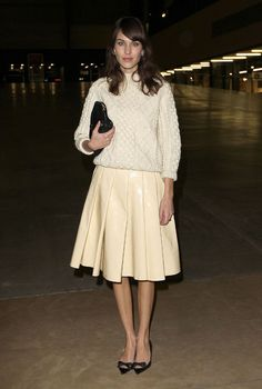 Alexa Chung in a cableknit sweater and pleated skirt